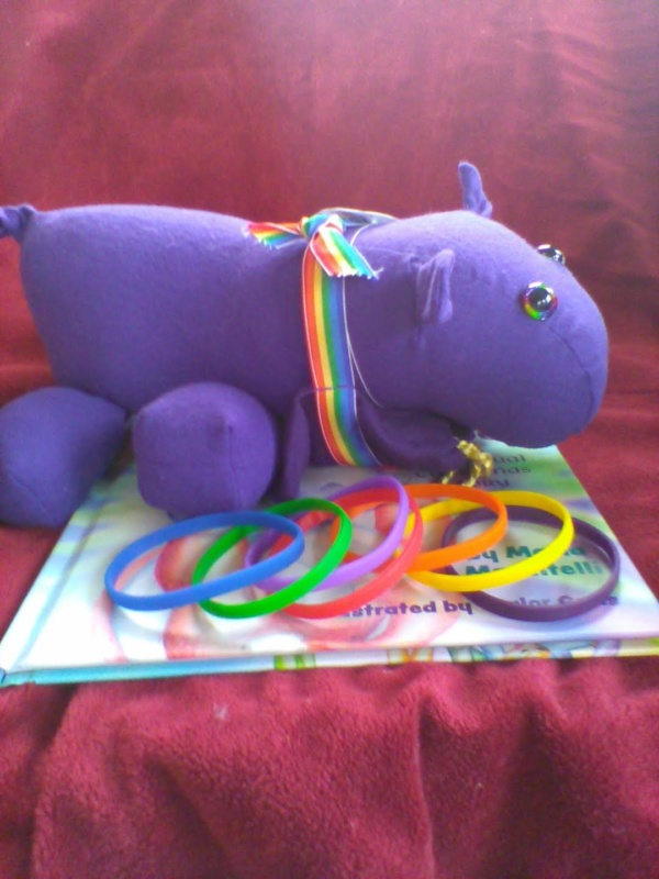 Pippo Toy with Book and Rings
